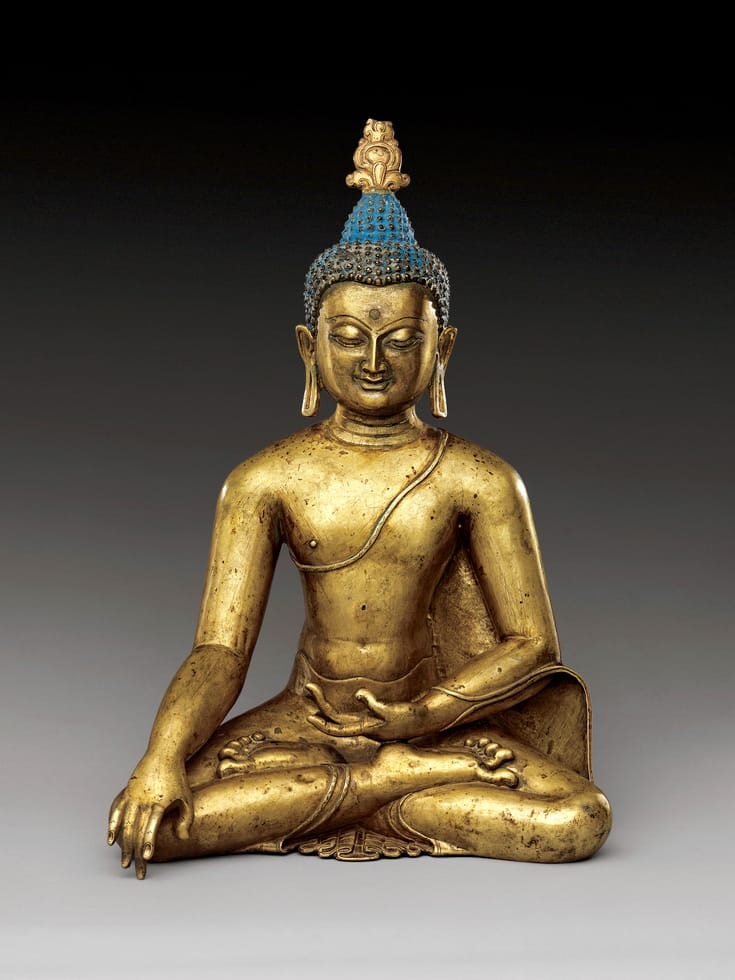 Sculpture of Shakyamuni Buddha sitting and touching the earth.