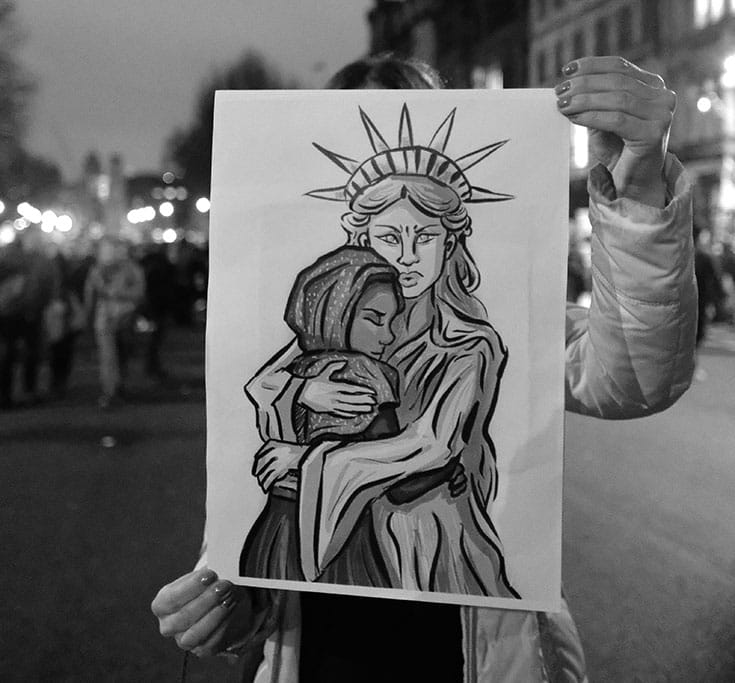 Demonstrator with a message at a rally in London. Photo by Alisdare Hickson.
