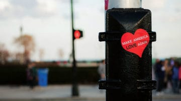 A sticker on a post that reads Make America Love Again
