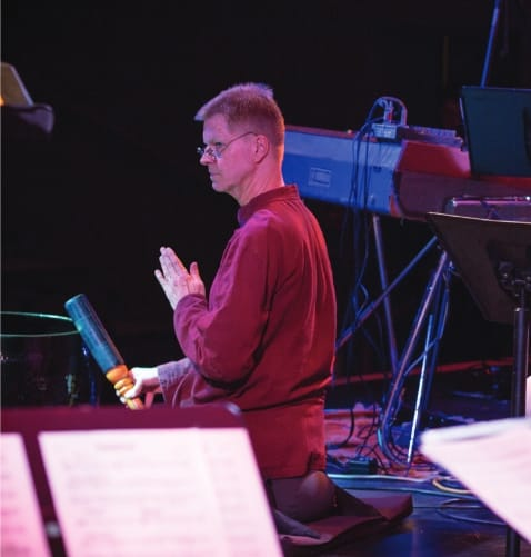 """Cline not only composed Oceans of Vows but supplied drums, percussion, and gongs. """"The listener,"""" he notes in the album's liner notes, """"is invited to come back to his or her body and breath at each sound of the loud bell (or any other bell!)."""" Photo by Ernestine Lona."""