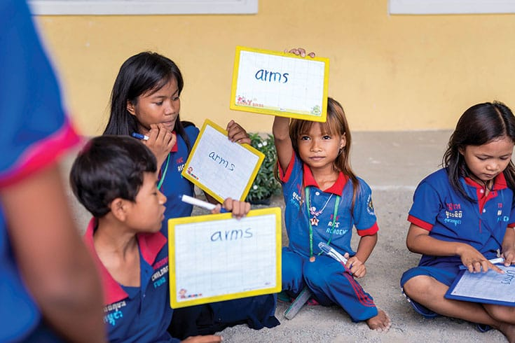 Thanks to CCF, most children in this community of 12,000 are now in school. Here, students proudly display their work in the Early Childhood Education program.