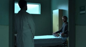 Danny Rand meditates as as a mental health professional looks on, mystified. From Marvel's Iron Fist.