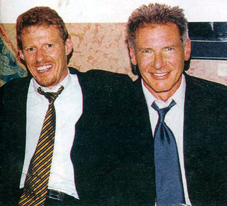 Scott Neeson, seen here with Harrison Ford, started out as a projectionist at a drive-in and worked his way up to president of Twentieth Century Fox International.