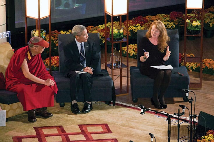 Krista Tippett discusses pursuing happiness with His Holiness the Dalai Lama and translator Thupten Jinpa at Emory University in 2010. Photo by Bryan Meltz / Emory Photo.