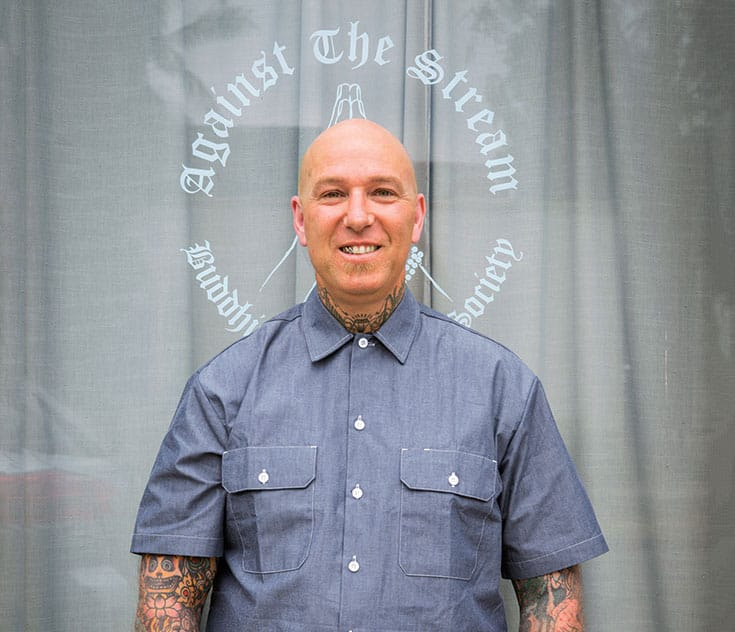 Noah Levine in front of Against the Stream Buddhist meditation society. Photo by Sarit Z. Rogers.