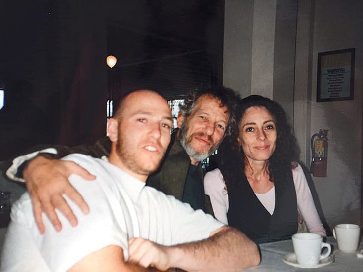 Noah Levine with his father and step-mother, Stephen Levine and Ondrea Levine.