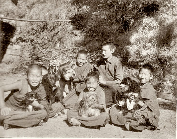 At age 11, Thupten Jinpa (far right, with his dog, Dorje) entered Dzongkar Choede monastery in southern India, where he was frustrated by the emphasis on rote learning.