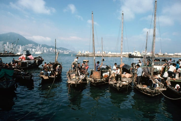 """Vietnamese refugees living on boats at a dockyard in Hong Kong. August, 1979. Photo by <a href=""""http://www.unmultimedia.org/s/photo/detail/101/0101346.html"""" target=""""_blank"""">John Isaac via the United Nations</a>."""