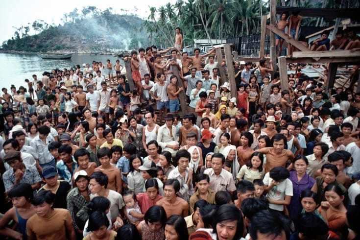 """Vietnamese refugees at the Pulau Bidong refugee camp in Malaysia. August, 1979. Photo by <a href=""""http://www.unmultimedia.org/s/photo/detail/101/0101363.html"""" target=""""_blank"""">John Isaac via the United Nations</a>."""