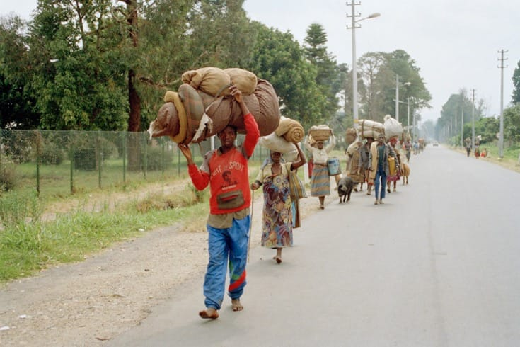 """Rwandan refugees returning home after the genocide. July, 1994. Photo by <a href=""""http://www.unmultimedia.org/s/photo/detail/107/0107630.html"""" target=""""_blank"""">John Isaac via the United Nations</a>."""