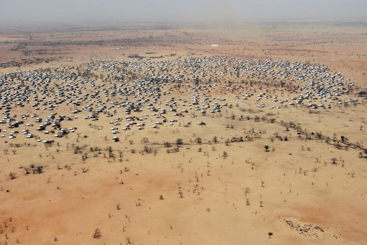 """An aerial view of Iridmi Camp in Chad, which houses refugees from Sudan. July, 2004. Photo by <a href=""""http://www.unmultimedia.org/photo/detail.jsp?id=146/14612&key=1&query=An%20aerial%20view%20of%20Iridimi%20Camp%20in%20Chad,%20that%20is%20housing%20refugees%20from%20Sudan.%20The%20camp%20was%20visited%20by%20Secretary-General%20Kofi%20Annan%20today.&lang=en&sf="""" target=""""_blank"""">Eskinder Debebe via the United Nations</a>."""