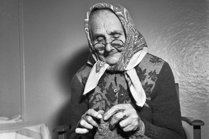 """An elderly women knits, having arrived home in Europe after decades spent living in China as a refugee of World War I. January, 1954. Photo via the <a href=""""http://www.unmultimedia.org/s/photo/detail/352/0352889.html"""" target=""""_blank"""">United Nations</a>."""