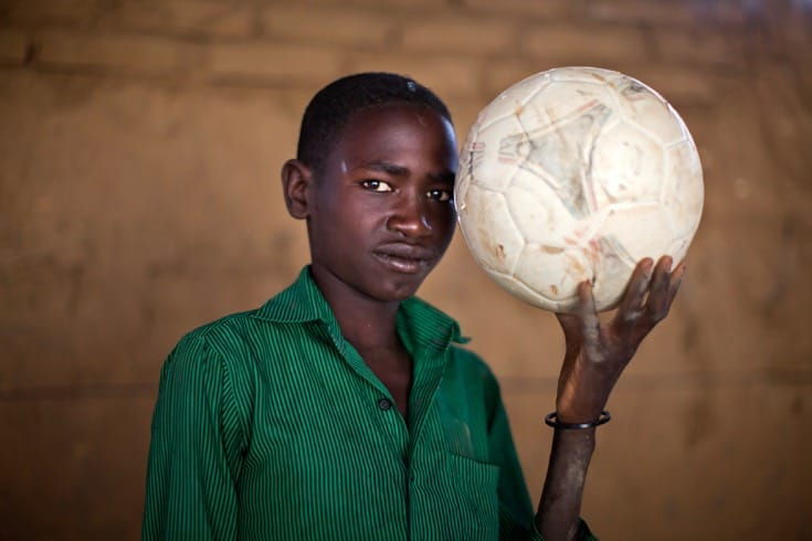 """Ismail, a thirteen-year-old displaced person in Sudan. June, 2014. Photo by <a href=""""_blank"""">Albert Gonzalez Farran via the United Nations</a>."""