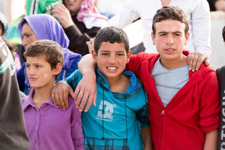 """A group of boys at a Syrian refugee camp in eastern Lebanon. Photo by Mark Garten via the <a href=""""http://www.unmultimedia.org/s/photo/detail/668/0668859.html"""" target=""""_blank"""">United Nations</a>."""