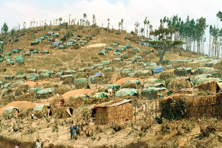 """A make-shift camp for refugees who fled violence in the Rwandan genocide. July, 1994. Photo by <a href=""""http://www.unmultimedia.org/s/photo/detail/789/0078960.html"""" target=""""_blank"""">John Isaac via the United Nations</a>."""