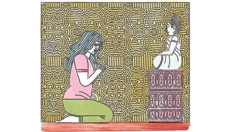 A Buddhist praying before a statue of a bodhisattva.