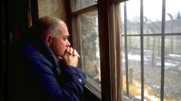 Bernie Glassman staring out of a window at Auschwitz.