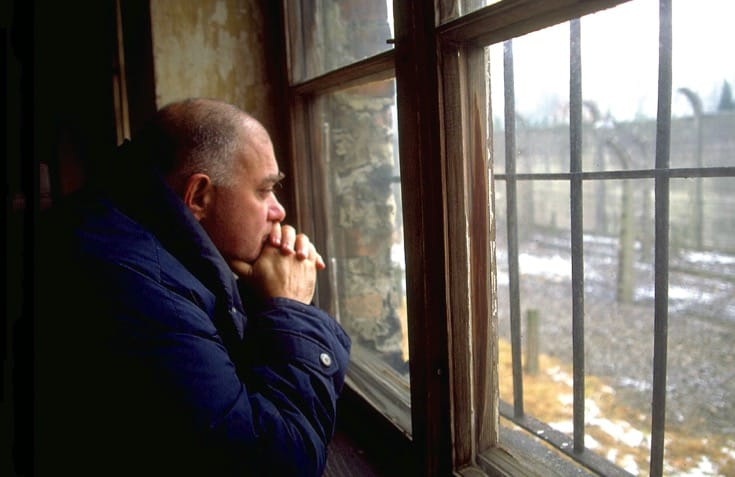 Bernie Glassman staring out of a window at Auschwitz.