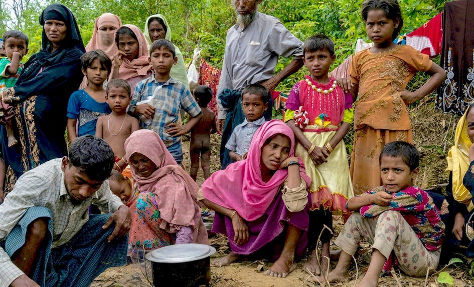 Rohingya family on the side of the road.