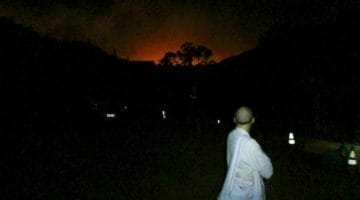 Fire in the distance as residents evacuate Abhayagiri Monastery in the middle of the night. Photo courtesy of Abhayagiri.