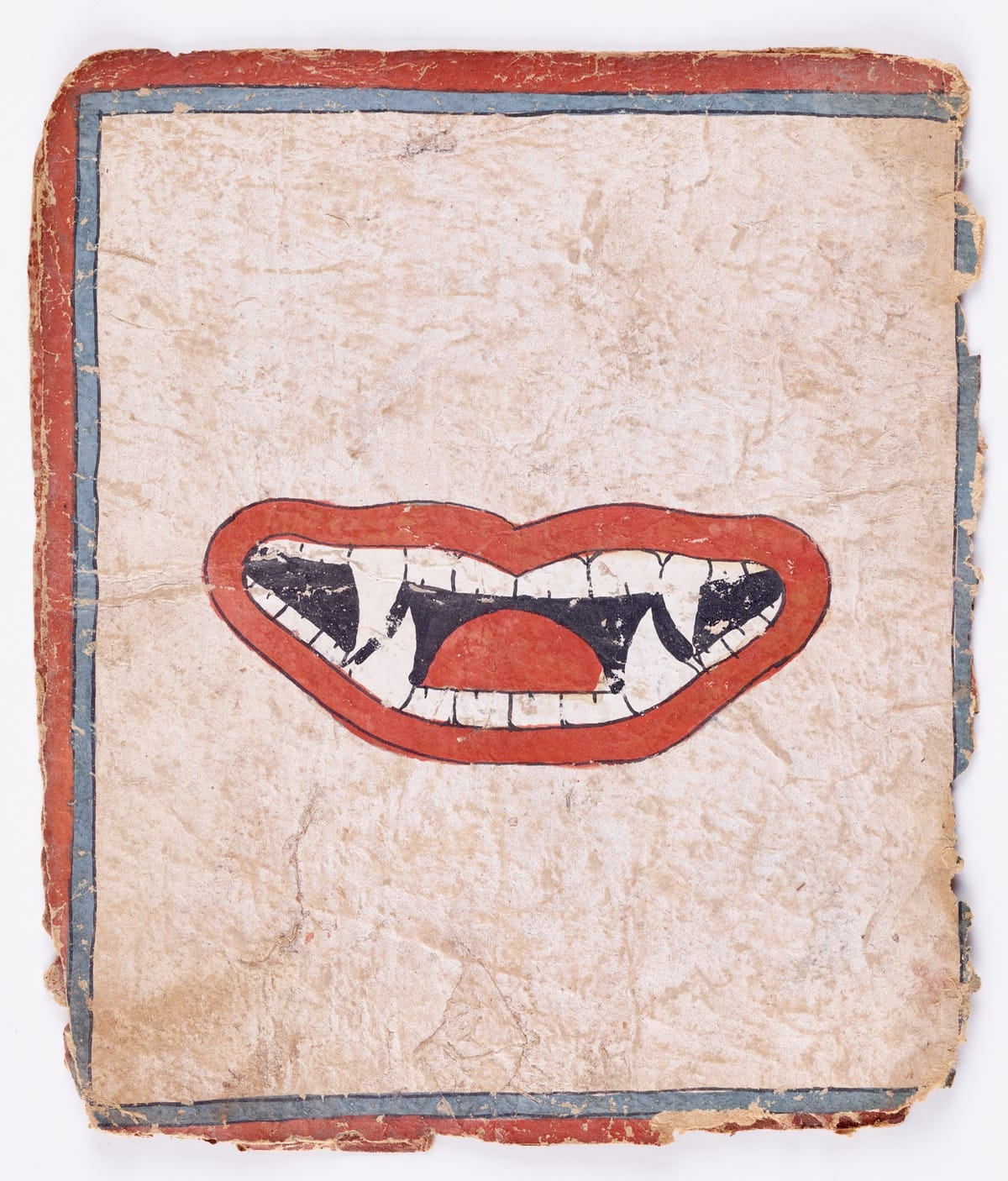 Image of fanged mouth on paper.