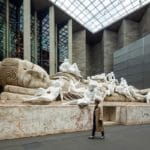 National Gallery of Australia unveils giant sculpture of sleeping Buddha covered in of Western figures