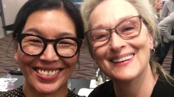 """Aspiring Buddhist"" activist Ai-Jen Poo walks Golden Globes red carpet with Meryl Streep"