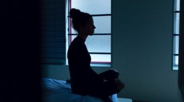 Sad woman sitting in meditation