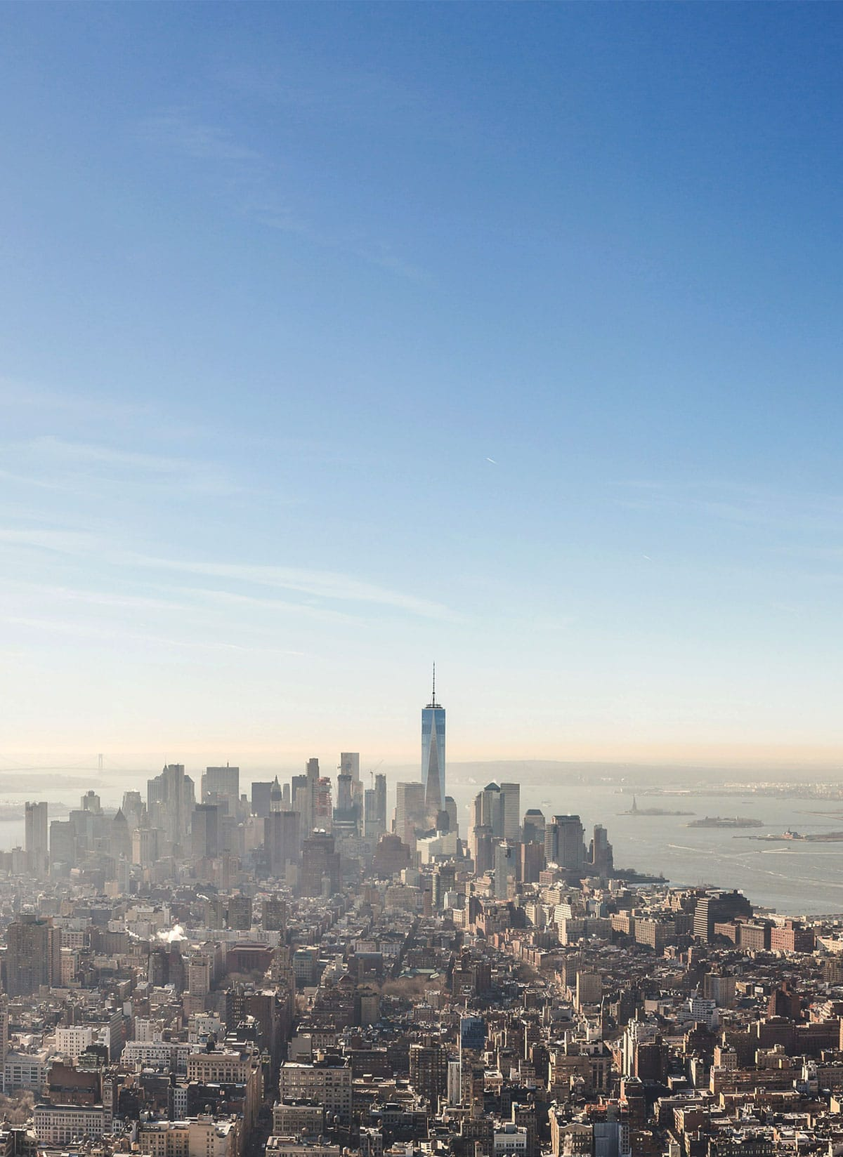 A photo of New York City with a blue sky above.