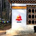 "Famous street artist ""invades"" Bhutan with Buddhist-inspired mosaics"