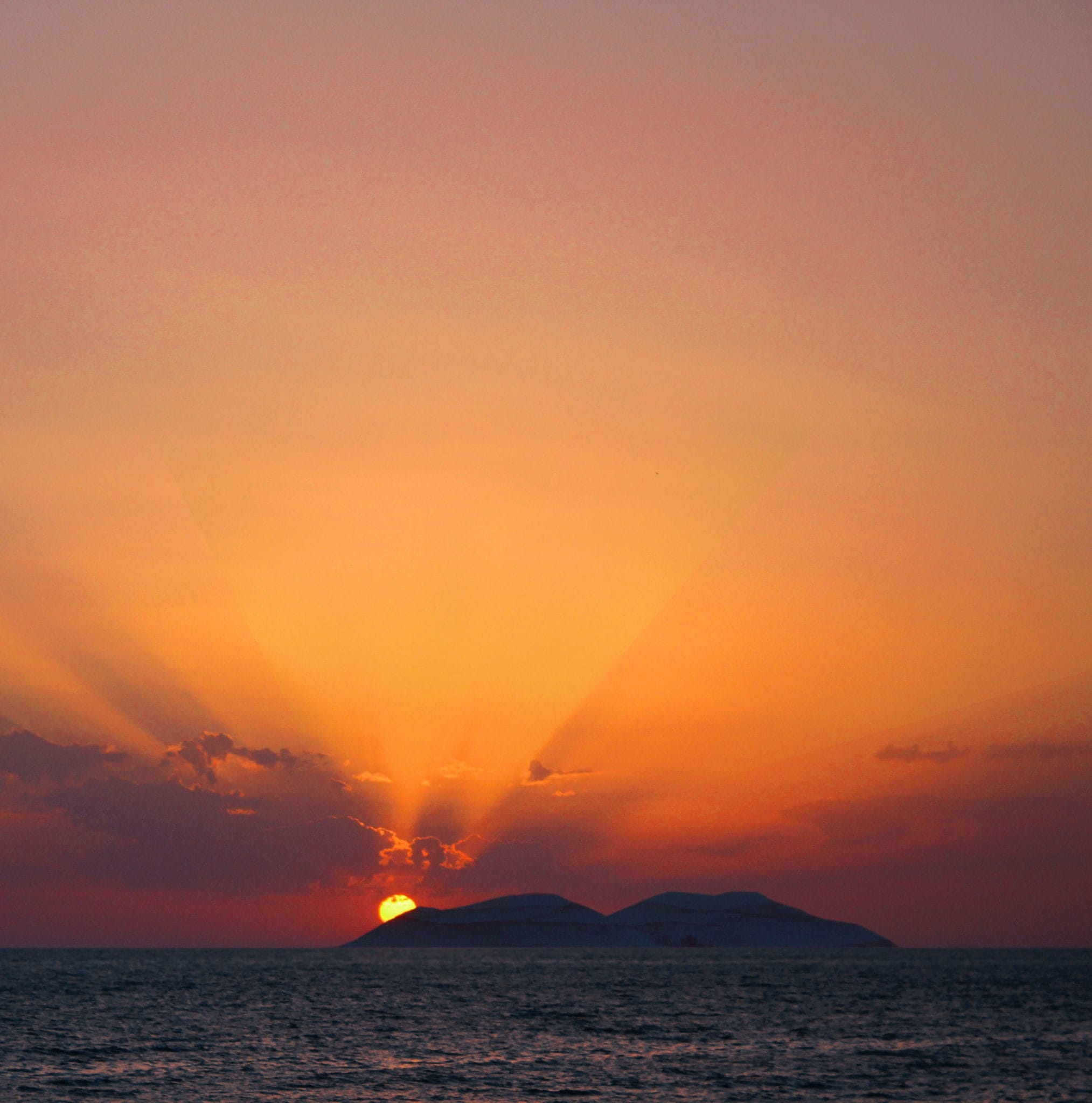 A orange and yellow sunset over the ocean.