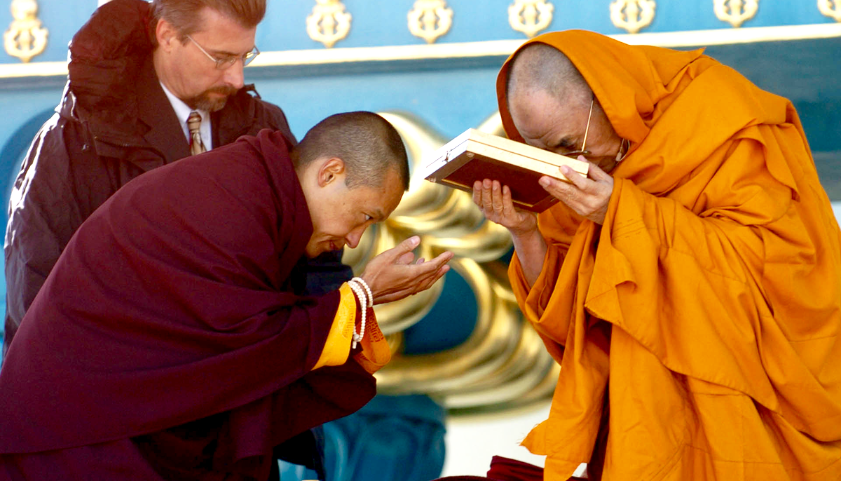 Sakyong Mipham presenting an award to the Dalai Lama