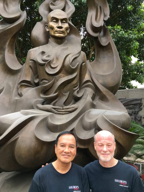 The author with his guide in front of a memorial to Thich Quang Duc.