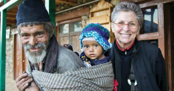 Man with baby on his back, with Roshi Joan Halifax.