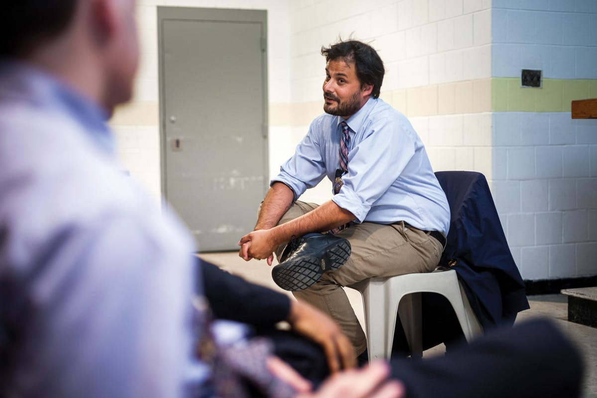 Justin von Bujdoss sitting and talking in Rikers Island