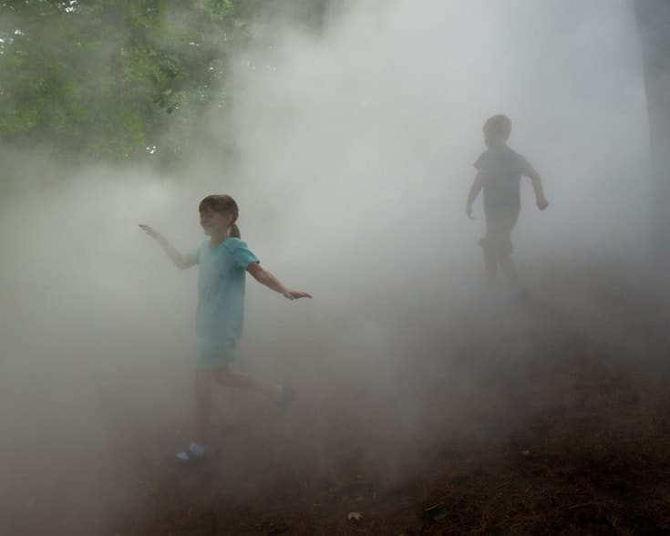 Children playing in fog.