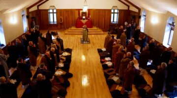 Dozens of priests gathered in a shrine hall.