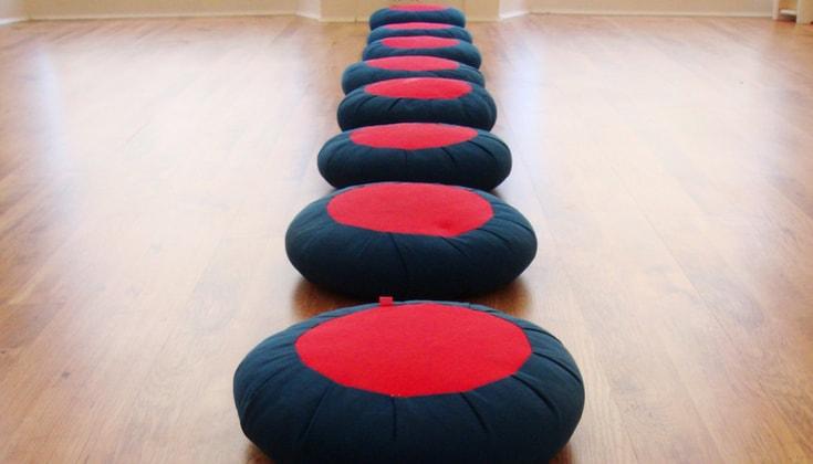 A row of meditation cushions.