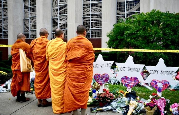 Monks standing at memorial outside Tree of Life synagogue.