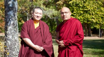 The two Karmapas standing next to each other.