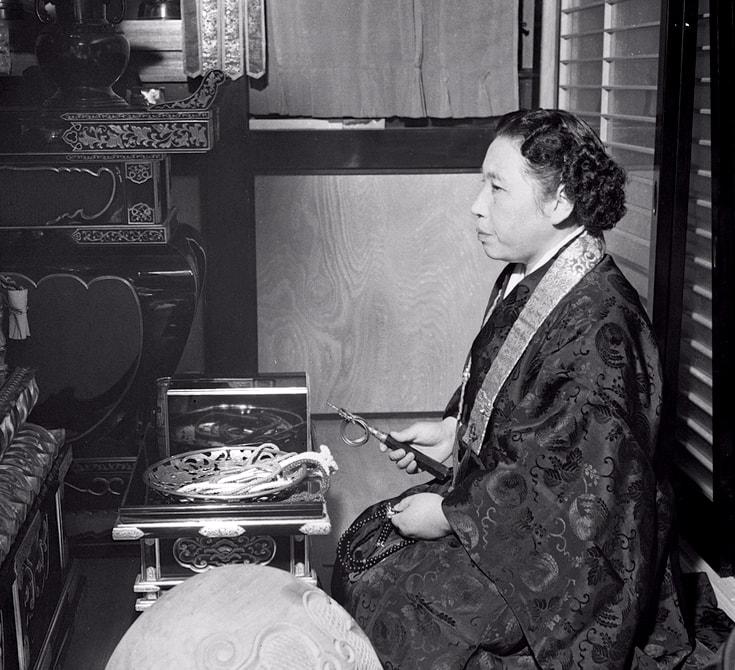 Tomoji Ito sitting.