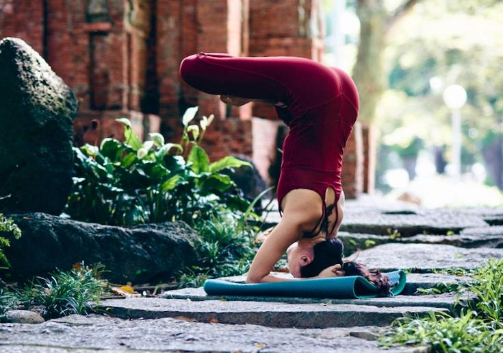 Yoga practitioner in upside down meditation posture.