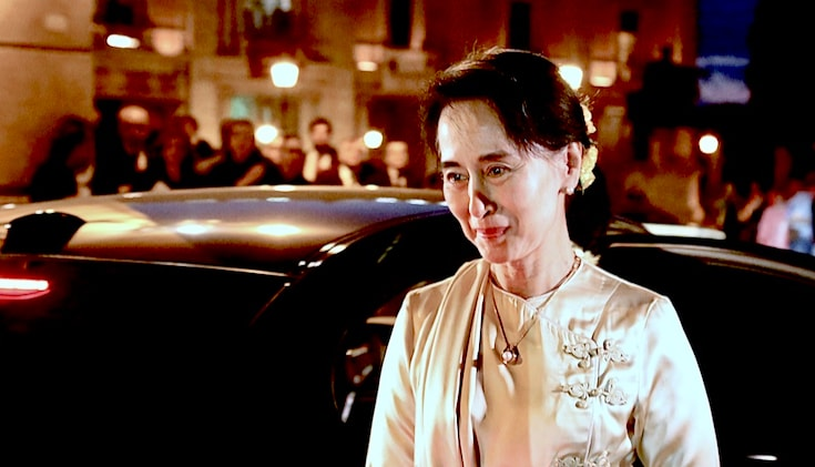 Aung San Suu Kyi getting out of a car.