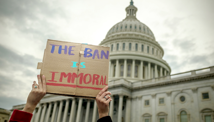 "Sign that reads ""the ban is immoral"" in front of Capitol Hill."