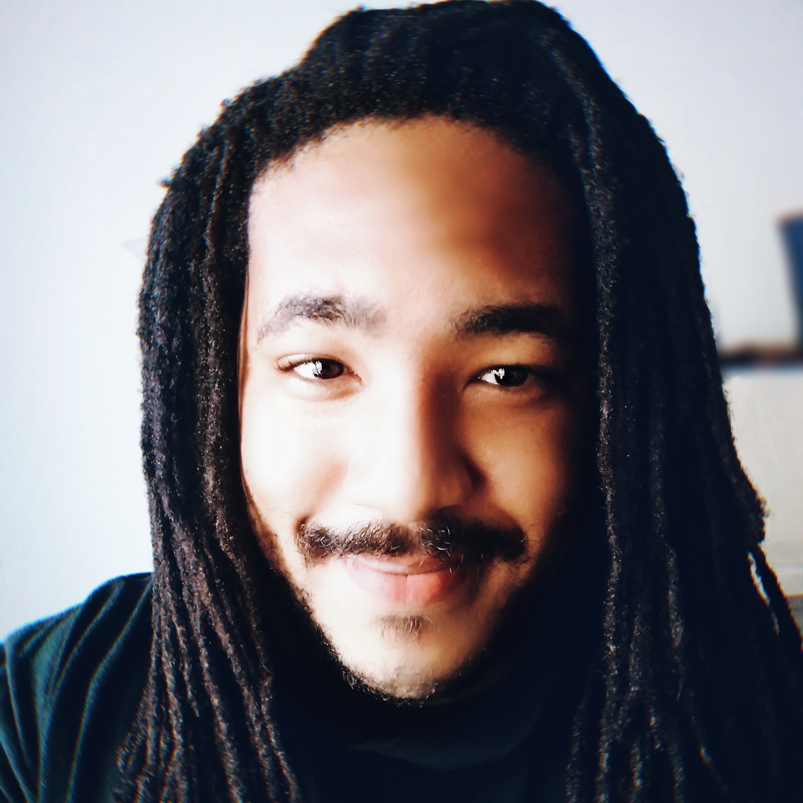 A portrait of a man smiling.