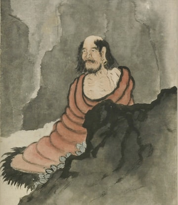 Bodhidharma meditating in a cave.