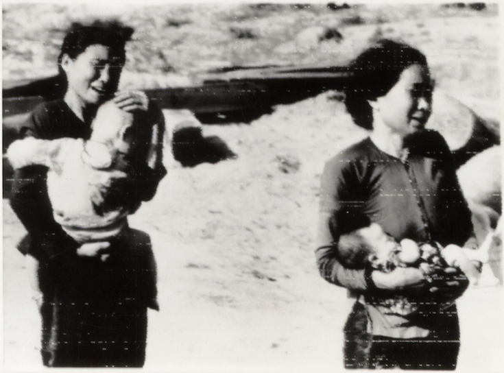 Vietnamese mothers crying while holding babies