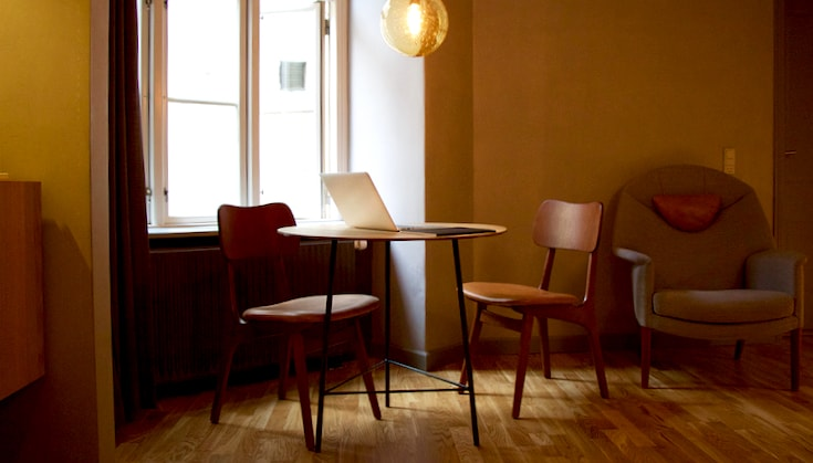 Chairs and table in a neat room.