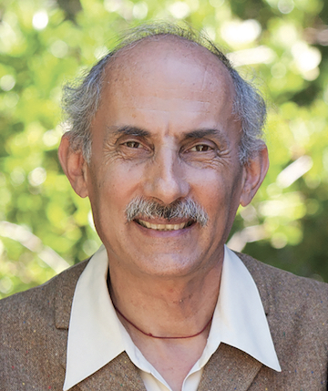 A photo of Jack Kornfield. He is balding with a moustache, and wearing a brown blazer and white collared shirt.
