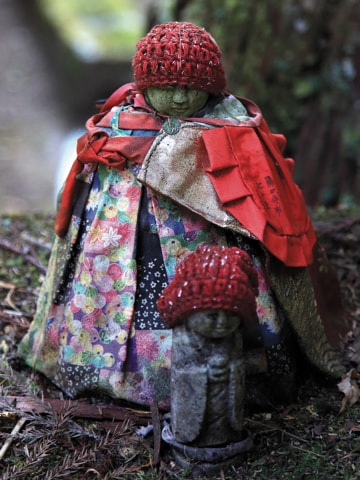 A statue covered in children's clothing.